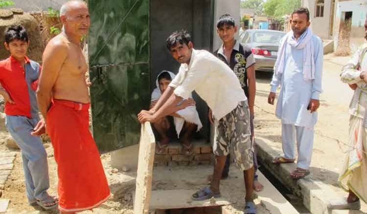 Villagers build toilets in three days